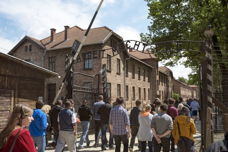 concentration camp: OSWIECIM - MAY 26: Tourists at the entrance of the concentration camp in Oswiecim, Poland on May 26, 2013. Oswiecim was the largest German concentration camp on Polish territory during World War II. Editorial