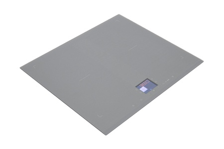 buit in: Grey glass induction hob isolated on white with clipping path Stock Photo