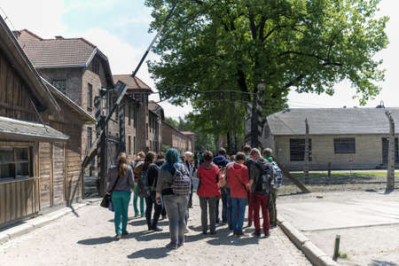 OSWIECIM - MAY 26  Tourists at the entrance of the concentration camp in Oswiecim, Poland on May 26, 2013