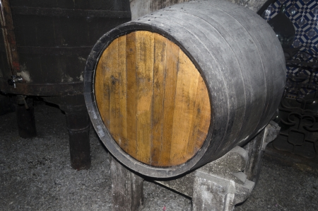 Old wine cellar with a large oak wine barrel Stock Photo - 21948744
