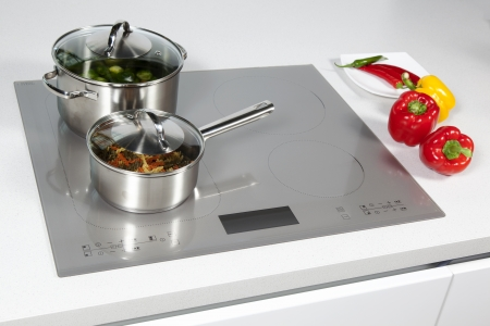 induction: Grey glass induction hob in the kitchen