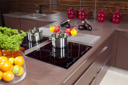 induction: Modern kitchen  with glass induction hob