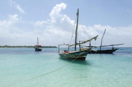Wooden boats on turquoise water in Zanzibar, Tanzania, Africa