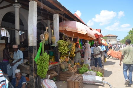 Sellers offer fruit and vegetables in the city market on 12 December 2013 in Stone Town, Tanzania