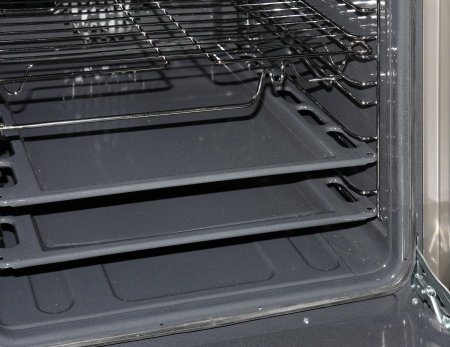oven tray: The inside of a stove oven