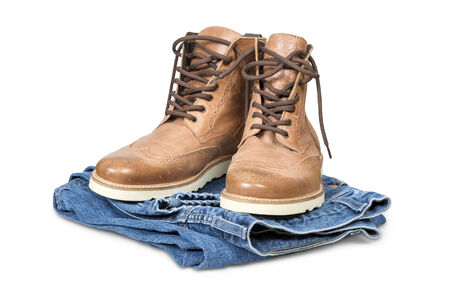 Hiking boots and blue jeans isolated over white with clipping path  photo