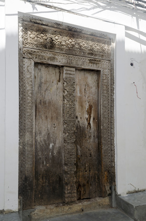 Old wooden door in Stone Town, Zanzibar photo