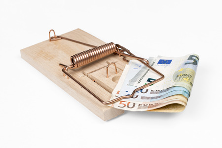 Mouse trap with Euro bills isolated over white  photo