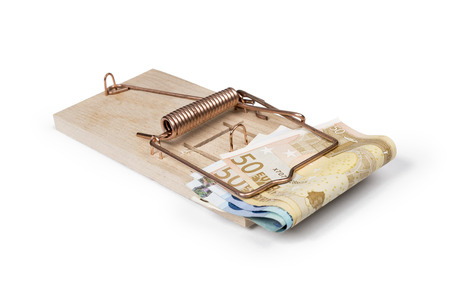 Mouse trap with Euro bills isolated over white with clipping path  photo
