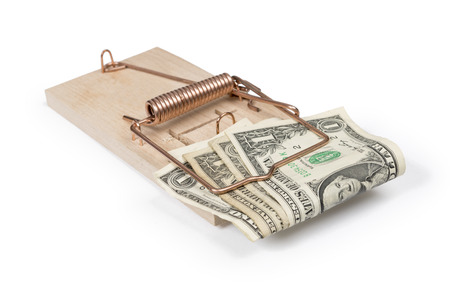 Mouse trap with dollar bills isolated over white with clipping path  photo