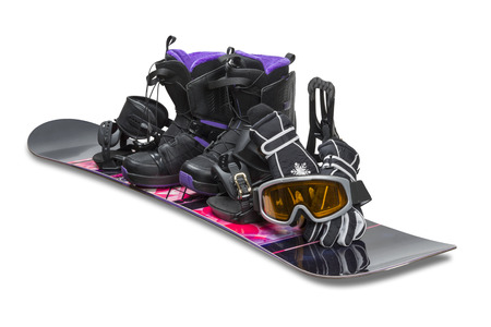 Snowboard with boot, gloves and goggles isolated on white  photo