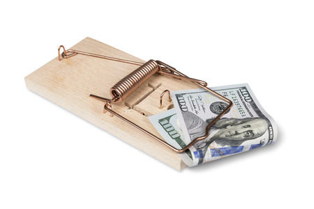 Risk of investment  Mouse trap with dollar bills isolated over white with clipping path  photo