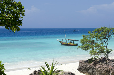 Wooden boat on turquoise water in Zanzibar, Tanzania, Africa Foto de archivo