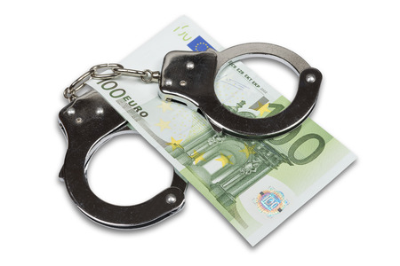 Handcuffs and Euro money isolated over white with clipping path  photo