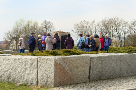 massacre: JEDWABNE - APRIL 6  Peoples at the monument of Jewish massacre in Jedwabne, Poland on April 6, 2014  Monument is a place for memory extermination of the Jews in Jedwabne, this happened in July 1941  Editorial