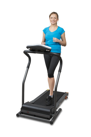 treadmill: Young woman running on treadmill, isolated over white  Stock Photo