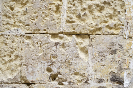 sandstone: Weathered old sandstone wall background