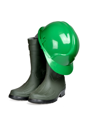 Protection helmet and rubber boots isolated over white with clipping path  photo