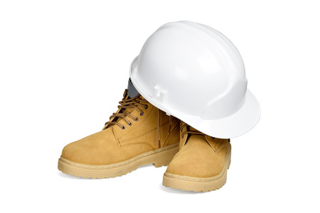 Protection helmet and boots isolated over white with clipping path  photo