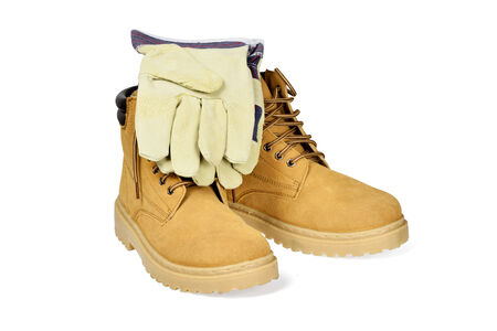Protective boots and gloves isolated on white with clipping path  photo