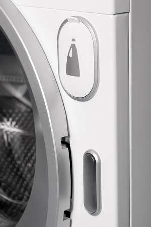 Detail of liquid soap container in washing machine  photo