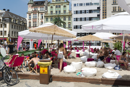 wroclaw: People on the beach in the center of the Old Town on the Salt Square as part of New Horizons Cinema, Poland s Largest Art House Cinema on 3 August 2014 in Wroclaw, Poland  Editorial