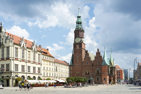 Tourists visit the Old Market Square and gothic Town Hall on 3 August 2014 in Wroclaw, Poland