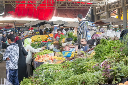 souq: Sellers offer fruit and vegetables in the Suk - city market  on 28 August 2014 in Agadir, Marocco