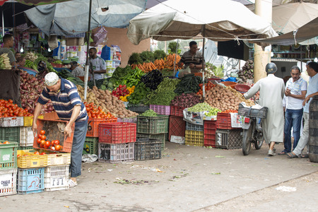 marocco: Sellers offer fruit and vegetables in the Suk - city market  on 28 August 2014 in Agadir, Marocco