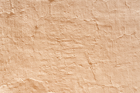 Ocher concrete wall textured background photo