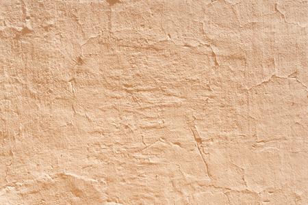 ocher: Ocher concrete wall textured background