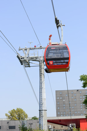 technical university: A cable railway connecting the buildings of the Technical University in two banks of the Oder river on 6 September 2014 in Wroclaw, Poland.