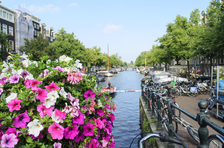 Flowers with bicycles and a canal in the background in Amsterdam, The Netherlands photo
