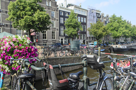 Flowers with bicycles and a canal in the background in Amsterdam, The Netherlands