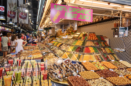 josep: People are watching and buying in the Mercat de Sant Josep de la Boqueria in one of the oldest markets in Europe on 8 August 2014 in Barcelona, Spain.. Editorial