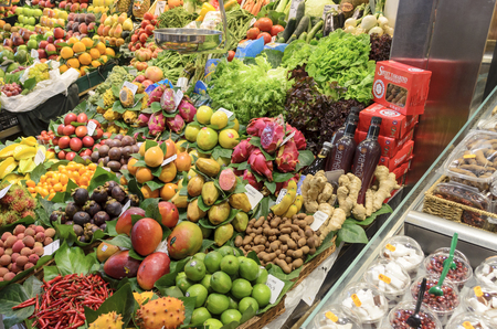Various colorful fruits and vegetables at the Mercat de Sant Josep de la Boqueria in Barcelona, Spain
