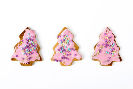 Homemade christmas gingerbread cookies on a white background photo