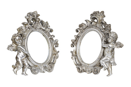 Set of oval baroque silver picture frames with cupid isolated on white photo