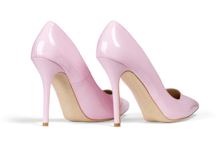 A pair of pink women heel shoes isolated over white with clipping path. photo