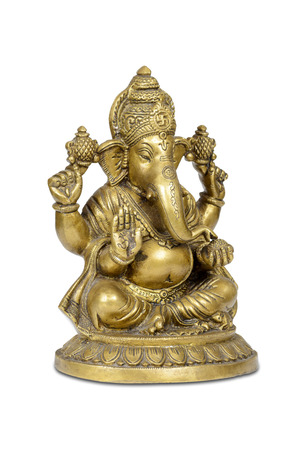 Figurine of Hindu god of wisdom, knowledge and new beginnings Ganesha isolated with clipping path. photo