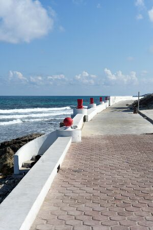 gulf of mexico: View of the promenade on the eastern shore of the ocean in Isla Mujeres, Mexico. The island is located 8 miles east of Cancun in the Gulf of Mexico.