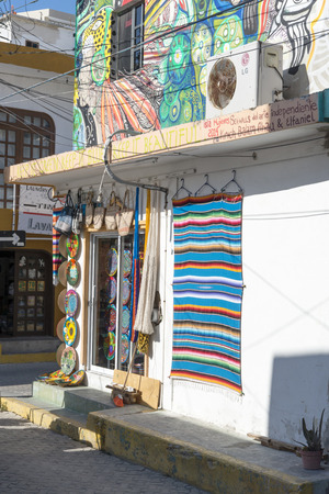 gulf of mexico: Side streets full of colorful souvenir shops on 21 January 2015 in Isla Mujeres, Mexico. The island is located 8 miles east of Cancun in the Gulf of Mexico.
