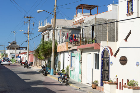 gulf of mexico: Side streets full of traditional colorful houses on 21 January 2015 in Isla Mujeres, Mexico. The island is located 8 miles east of Cancun in the Gulf of Mexico. Editorial