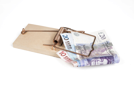 Mouse trap with Euro and Pound bills isolated over white with clipping path. Stock Photo