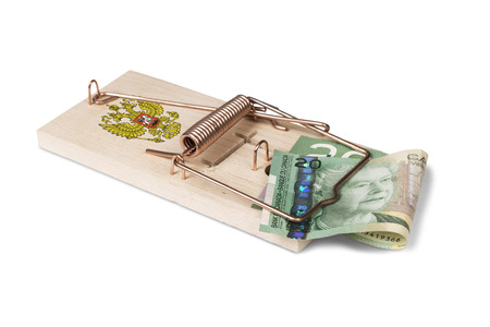 mouse trap: Russian mouse trap with Canadian dollar bill isolated over white with clipping path.