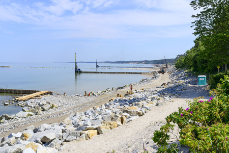 facilitate: Workers build a breakwater that Facilitate the construction of the beach on 4 July 2015 in Ustka, Poland.