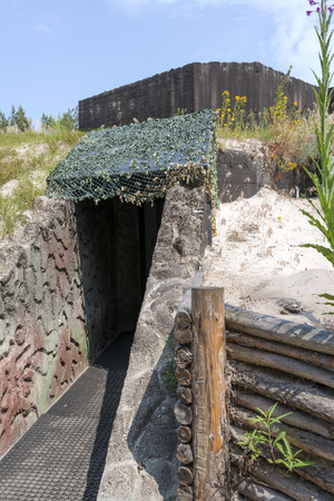 tree world tree service:   fortifications Bunkers Bluchnera of the Second World War on the Baltic coast in Ustka. Poland
