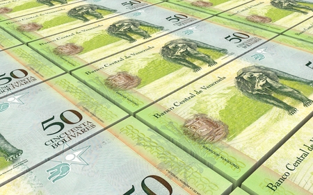 venezuelan: Venezuelan Bolivares bills stacks background.