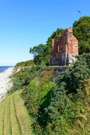 remained: Ruins of gothic church from 1415th century located in Trzesacz near the Baltic Sea. Currently, Remained only fragment of southern wall. Trzesacz village, Poland, Europe.