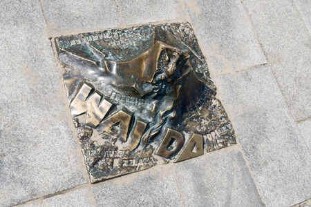 memorial plaque: The memorial plaque in brass on the sidewalk of famed Polish movie director Andrzej Wajda at Avenue of Stars on 16 August 2015 in Miedzyzdroje, Poland.